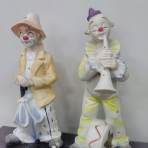 Two bisque ceramic hobo clowns